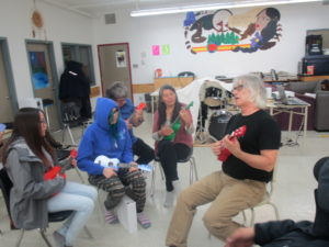 Photo: Richard leads a ukulele session, Jackie takes part.